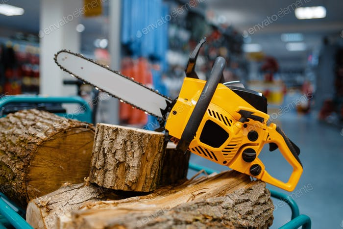Chainsaw in power tool store closeup, nobody