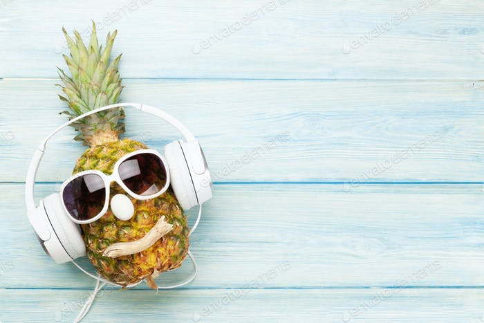 Pineapple with sunglasses and headphones