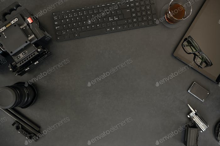 Overhead of digital tablet and filming equipment with coffee on table