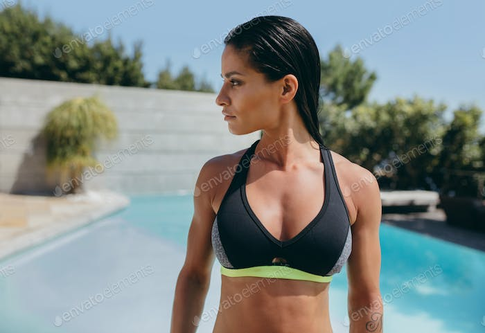 Muscular woman in sports bra