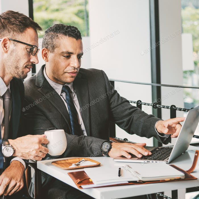 Two Businessmen Cafe Meeting Laptop Concept