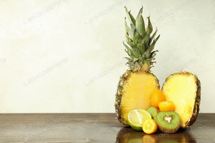 Exotic fruits on wooden table against white background