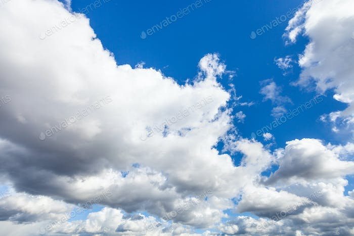 low cumulus clouds in dark blue sky in september
