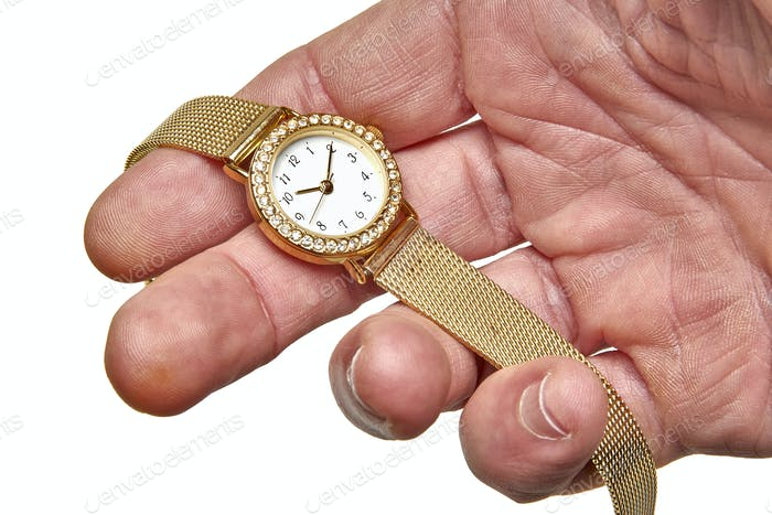 Women gold watch with the brilliants