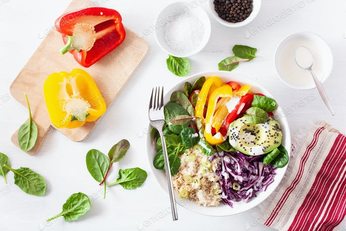 veggie couscous lunch bowl with avocado, bell peppers, spinach a