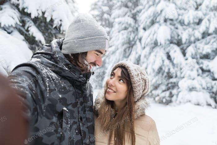 Man Taking Selfie Photo Young Romantic Couple Smile Snow Forest Outdoor