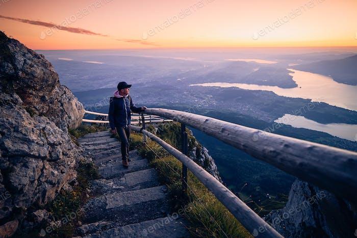 Man walking on mountain footpath