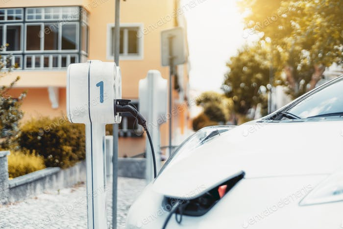 An electric car charging outdoors