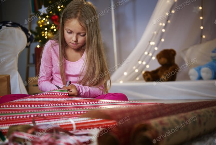 Cute girl cutting a Wrapping paper