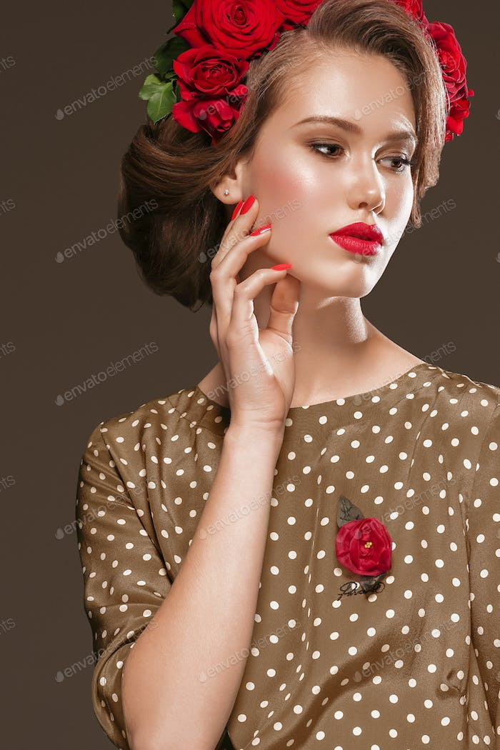 Hairstyle with Roses Flowers Woman Glamour Beauty Portrait. Studio shot.