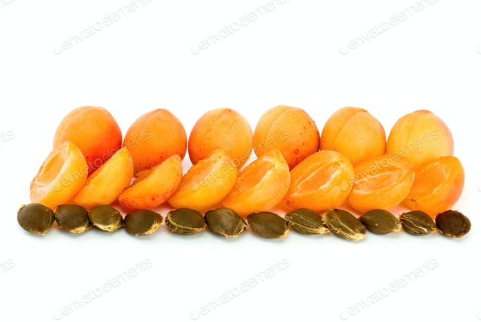 Few whole apricots and some halves with kernels