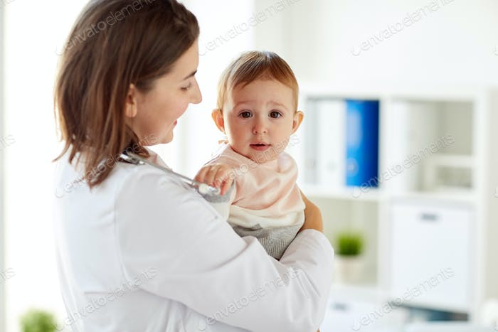 happy doctor or pediatrician with baby at clinic
