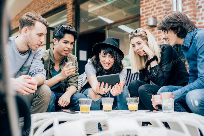 Group of young multiethnic friends sitting in a bar