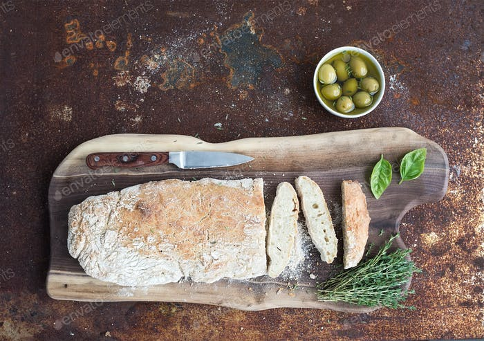 Freshly baked homemade ciabatta bread with olives, basil and thyme