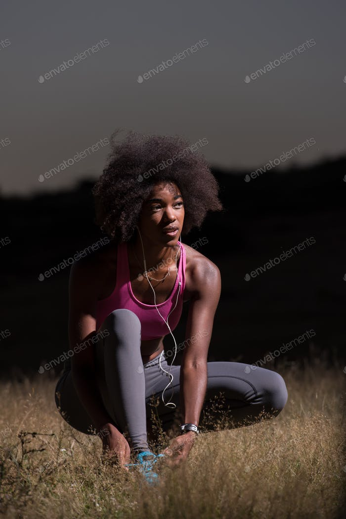 black woman runner tightening shoe lace