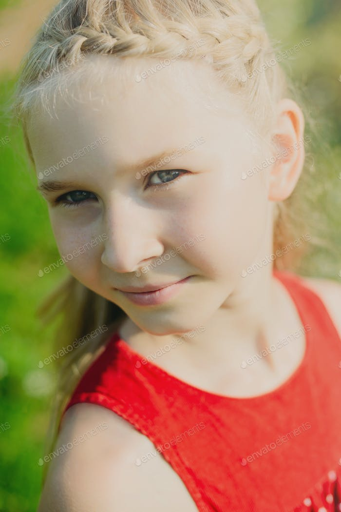 portrait of cute little blonde girl