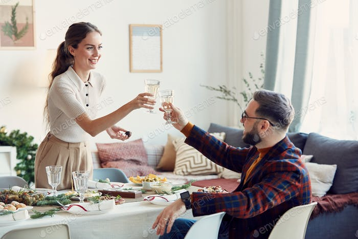 Elegant Couple Toasting at Christmas Party