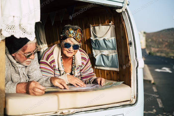 Happy old senior couple enjoy the travel
