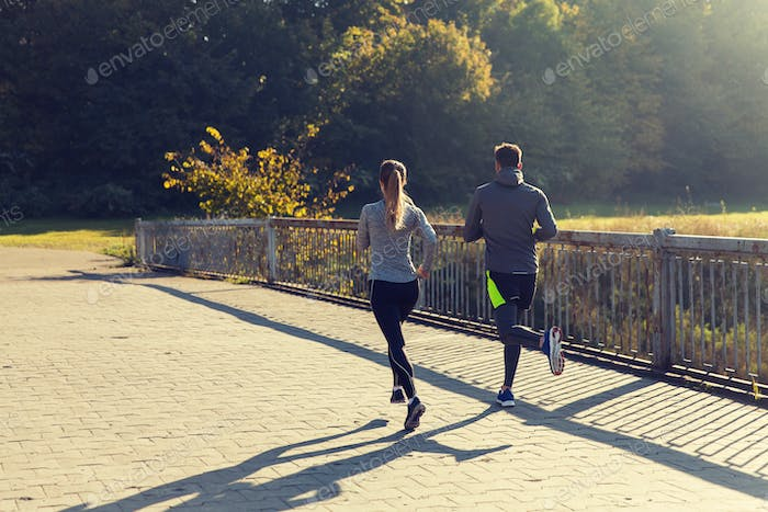couple running or jogging outdoors