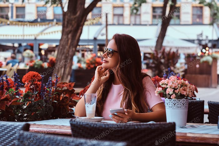 Portrait of a middle aged businesswoman sitting at an outdoor cafe.
