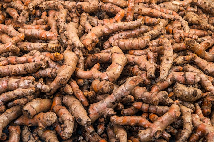 Turmeric roots close up display in the fresh vegetable market
