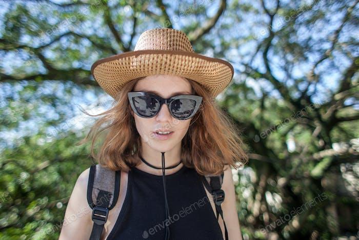 white female traveler on nature forest background
