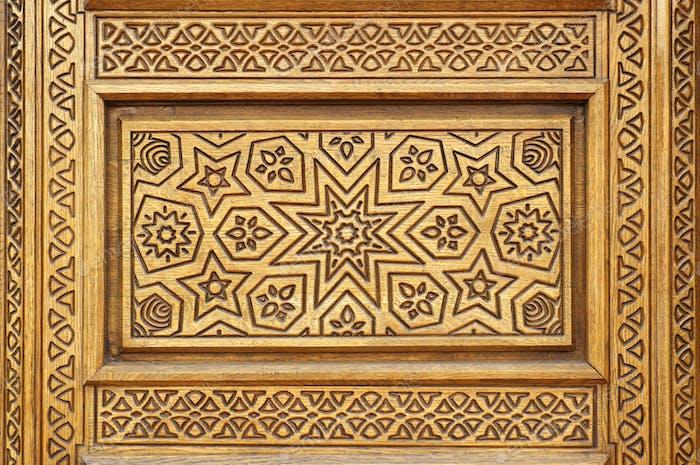 Star pattern miiled on wood.