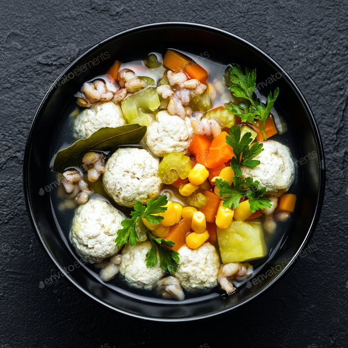 Delicious vegetable soup with chicken meatballs and pearl barley