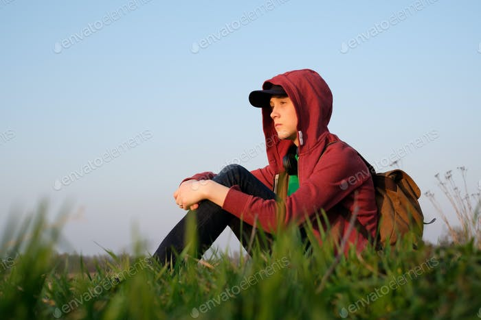 Teenager on green lawn