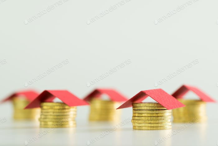 Houses made from coins and red color roof