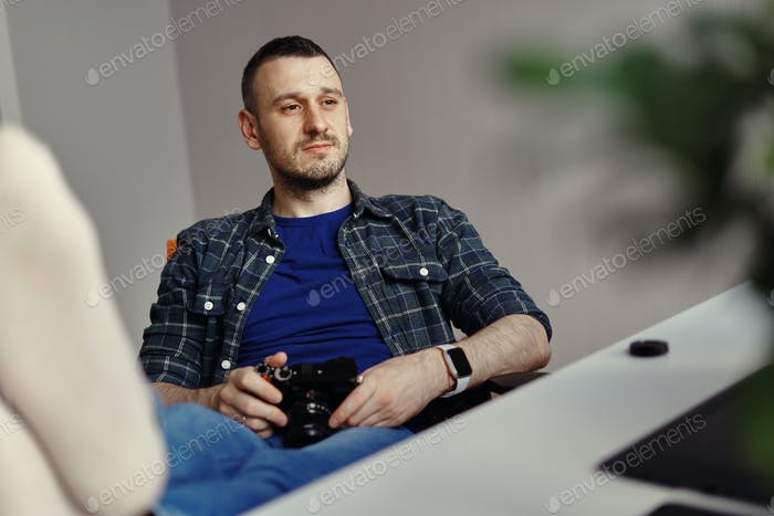 Photographer resting with camera in his hand