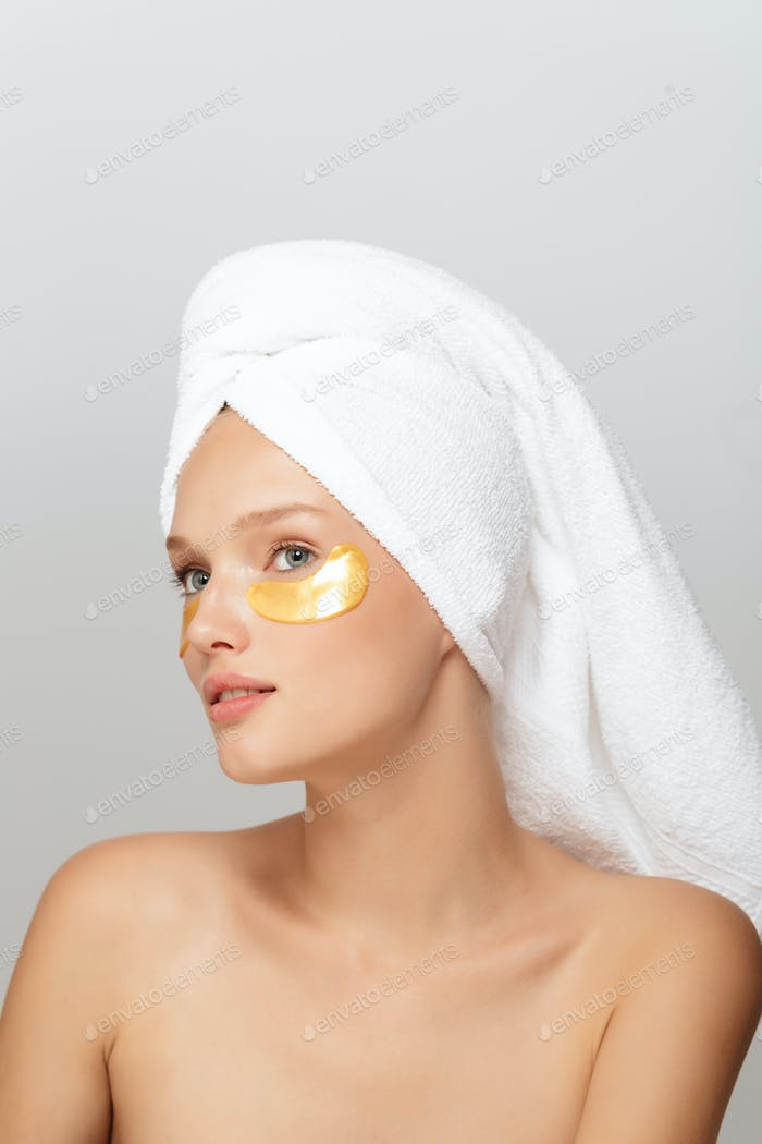 Portrait of beautiful girl with white towel on head without make