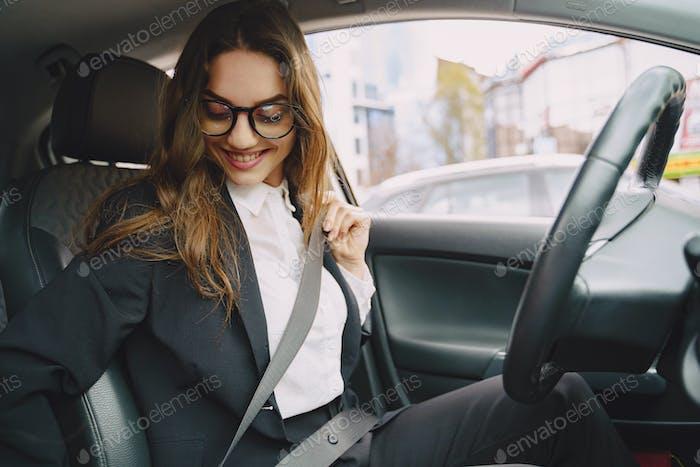 Businesswoman sitting inside a car