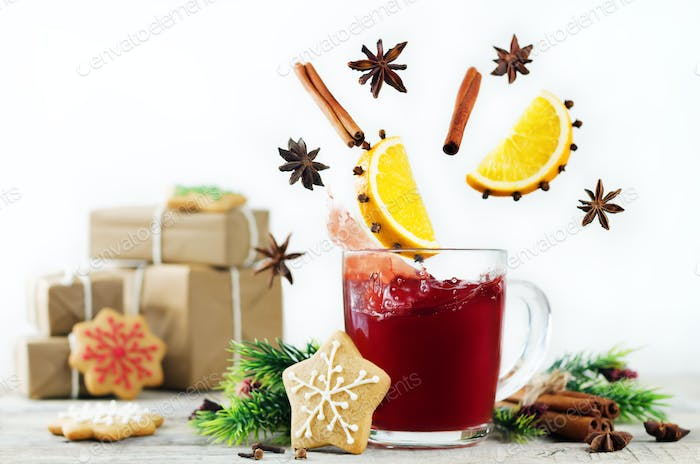 Mulled wine with flying ingredients to prepare it