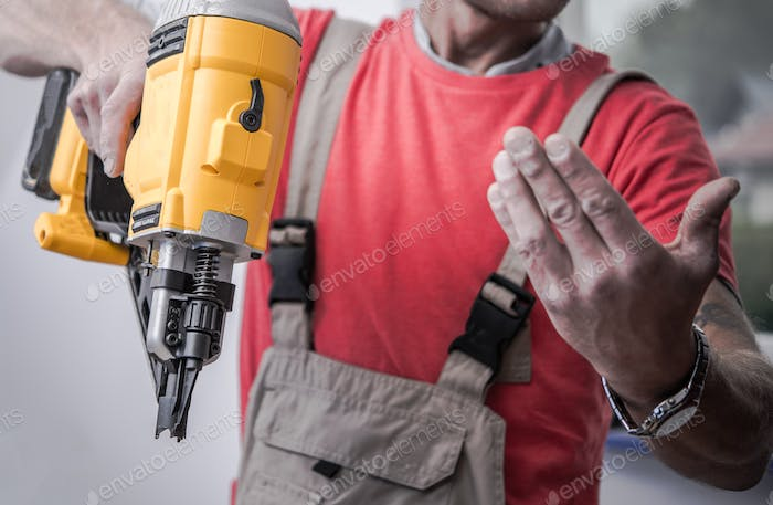 Contractor with Nail Gun