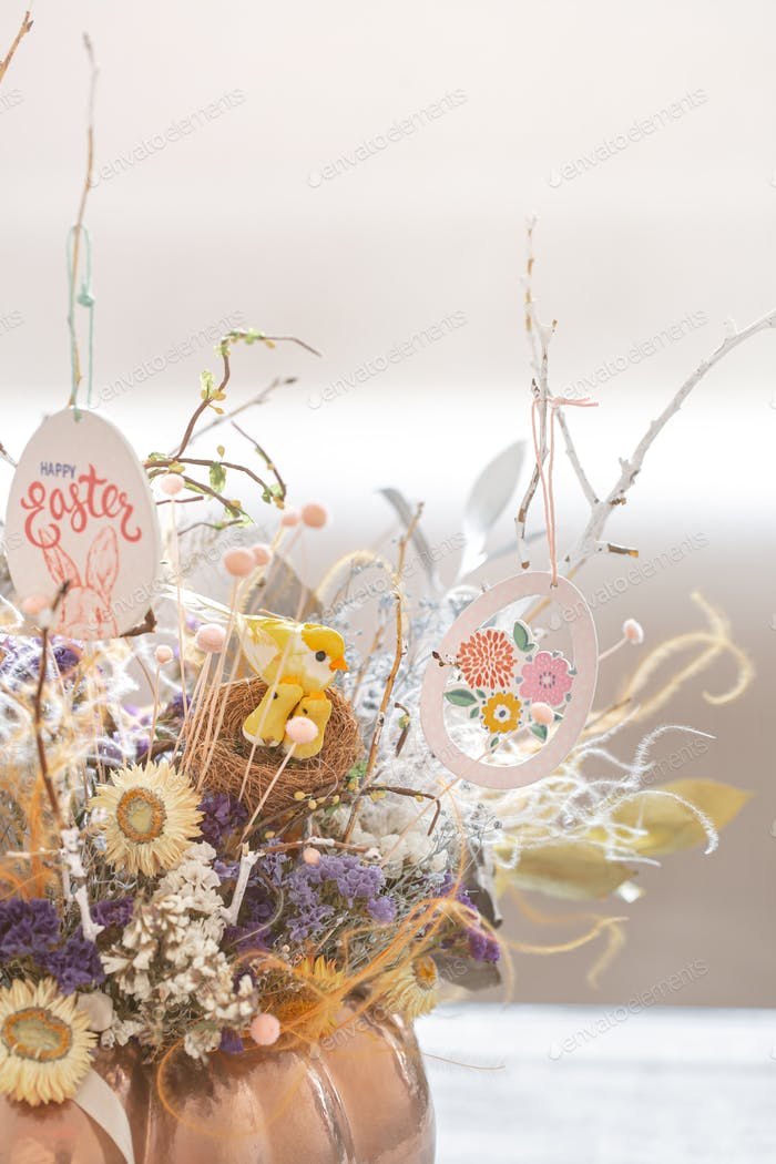 A beautiful Easter arrangement with flowers and eggs .