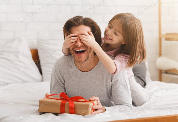 Preschooler girl greeting her beloved dad with birthday