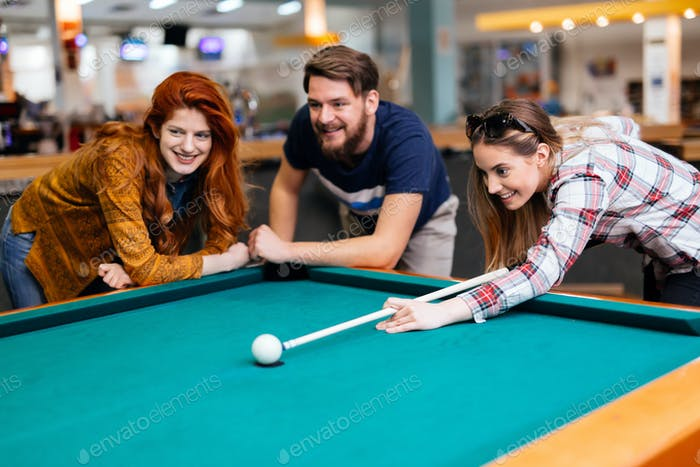 Friends enjoying playing snooker