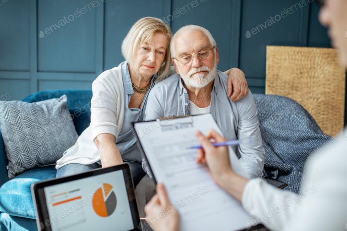 Senior couple with consultant at the office