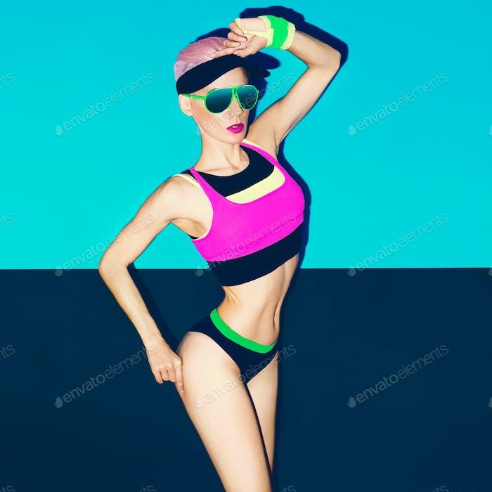 slim athletic girl in bright trendy sportswear. Fitness Fashion