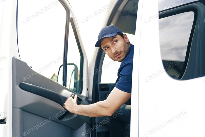 Man backing out delivery van