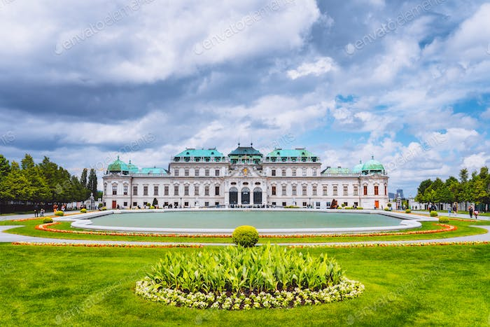 Belvedere palace Vienna Austria with spring flowers and cloudscape