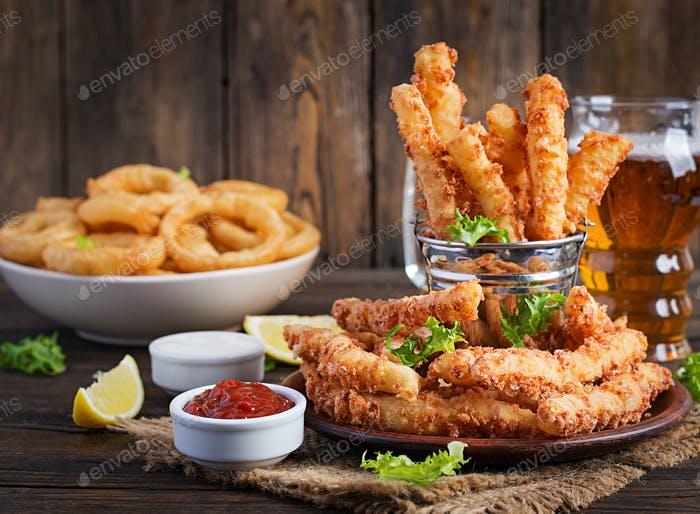 Cheese sticks  and onion rings in batter with sauce. Beer snacks. Copy spase