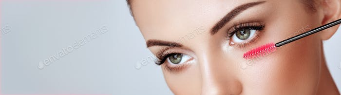 Beautiful woman with long false eyelashes