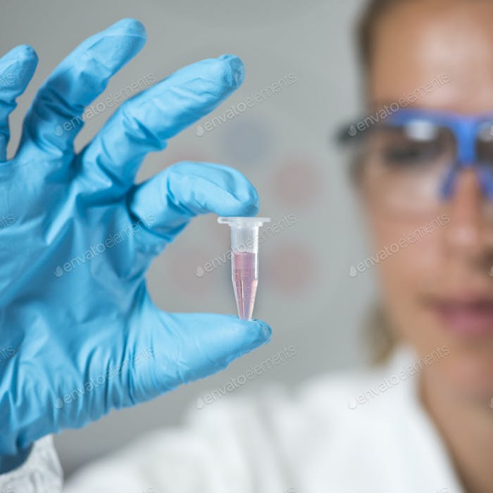 Female Researcher Holding a Micro Tube